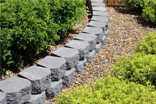 Curved_garden_edging_Classic_Wall_Charcoal_with_Pebbled_landscape