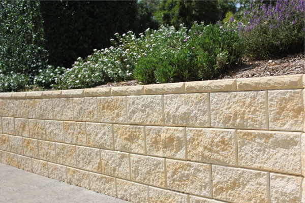 Vertical_faced_retaining_wall_Fraser_Sand_with_raised_garden_including_hedges_and_flowers