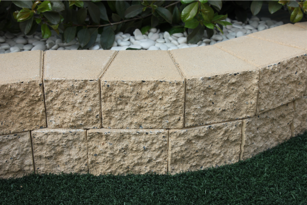 Close_up_of_split_face_concrete_weed_free_garden_edge_blocks