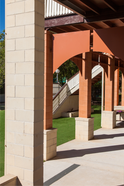 Pillars_created_using_Canyon_and Ivory_smooth_faced_masonry_blocks_matching_the_aesthetics_of_the_school_building