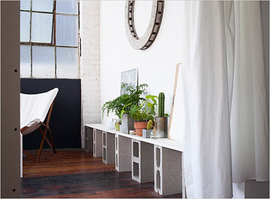Industrial_styled_room_featuring_a_shelf_supported_by_Grey_Block