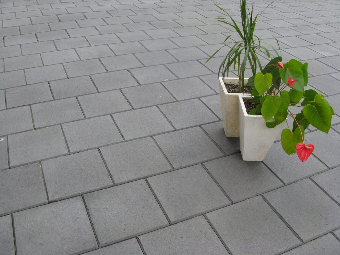 300x300x40mm_charcoal_paver_in_an_outdoor_setting_with_pot_plants