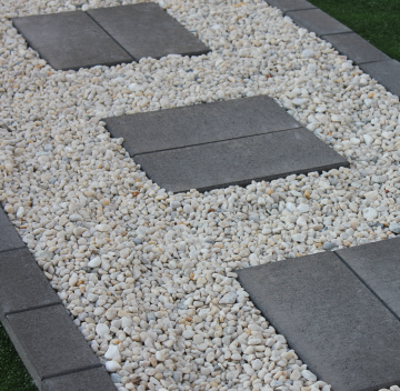 Cheap_way_to_create_stepping_stones_with_Charcoal_pavers_set_in_with_white_pebbles
