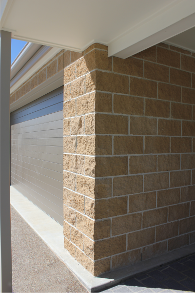 Splitface_Coloured_Masonry_feature_exterior_wall_at_front_of_house
