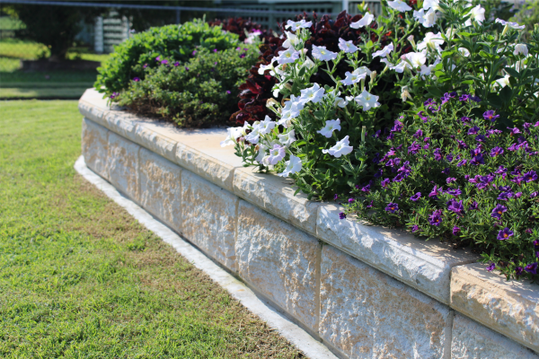 TrendStone_Retaining_Wall_used_as_a_Flower_Garden_Edging_with_mowing_strip