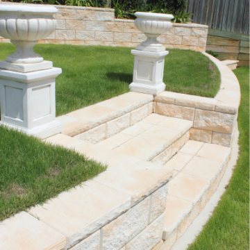 Elegant_terraced_TrendStone_Retaining_Wall_with_stairs_and_mowing_strip