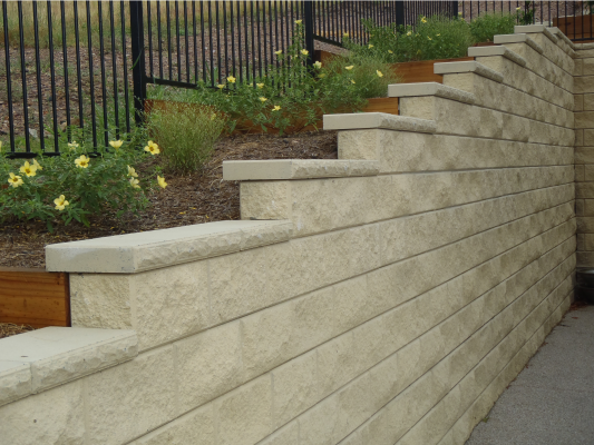 High_retaining_wall_Ivory_with_flower_garden_and_fence