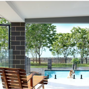 Outdoor_living_area_with_architectural_Charcoal_masonry_walls