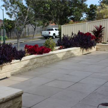 Patio_with_TrendStone_Wall_used_as_garden_beds