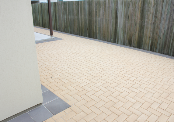 Small_backyard_with_herringbone_paving_laid_by_a_landscaper