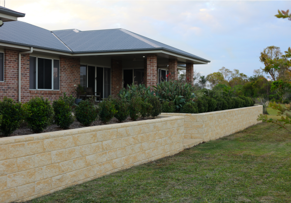 New_home_with_metre_high_retaining_wall_in_sandstone_look