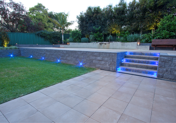 Metre_high_TrendStone_retaining_wall_with_steps_and_lights_installed_by_a_landscaper